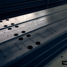 Laser cutting of components for industrial vehicles